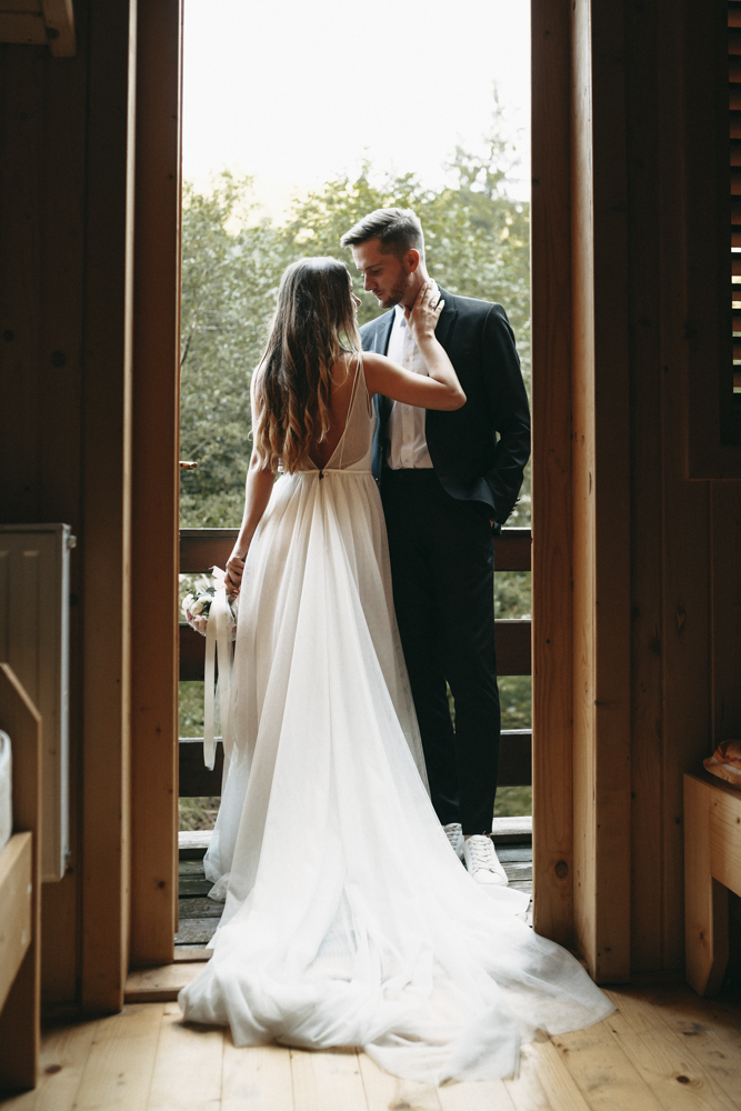 Full length portrait of a beautiful bride and groom embracing on