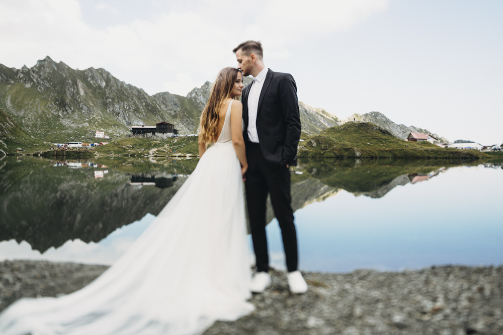 Full length portrait of an amazing wedding couple while groom is