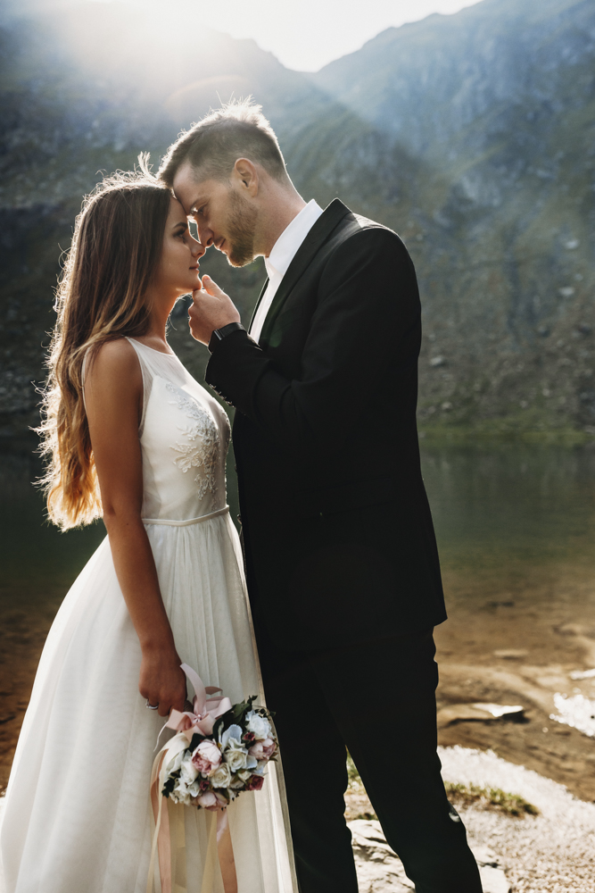 Side view portrait of a amazing couple looking to each other clo