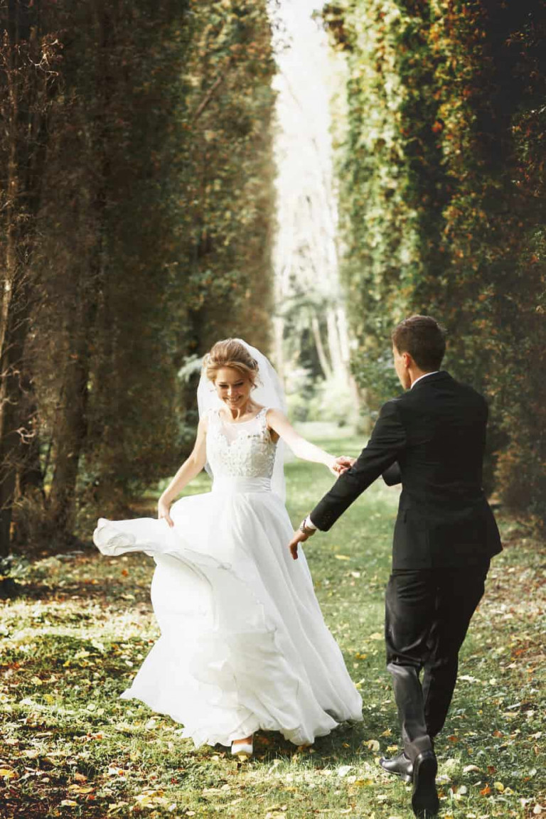 luxury stylish young bride and groom on the background  spring s