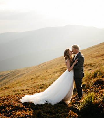 Beautiful wedding couple, bride and groom, in love on the backgr