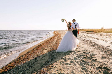 bride and groom on the seashore. wedding concept on the sea, on