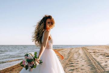 happy bride by the sea